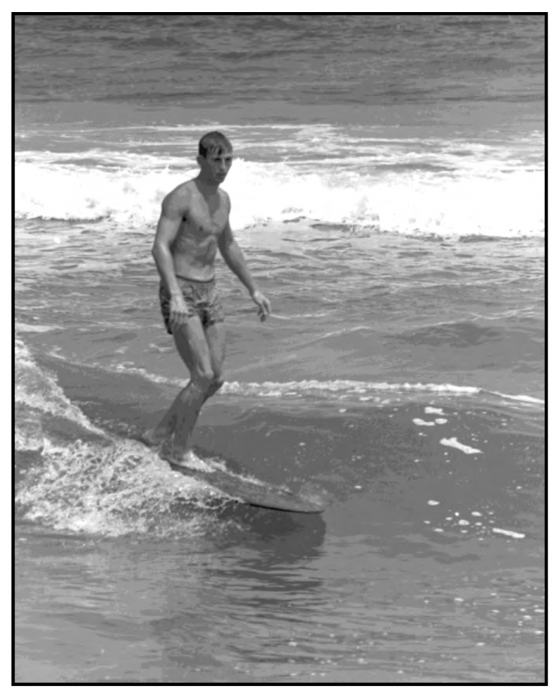 Herman Pritchard test rides one of his handmade DANPRI surfboards at Kure Beach, New Hanover County in 1965.
